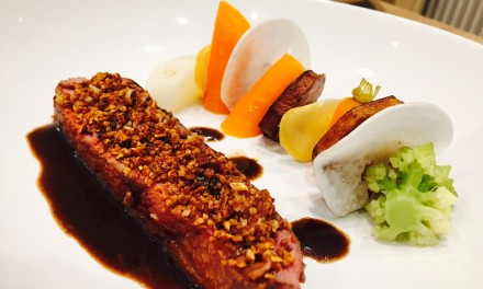 Duck filet in cereals crust, vegetables and balsamic honey sauce