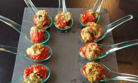 Cherry tomatoes stuffed with snails au gratin