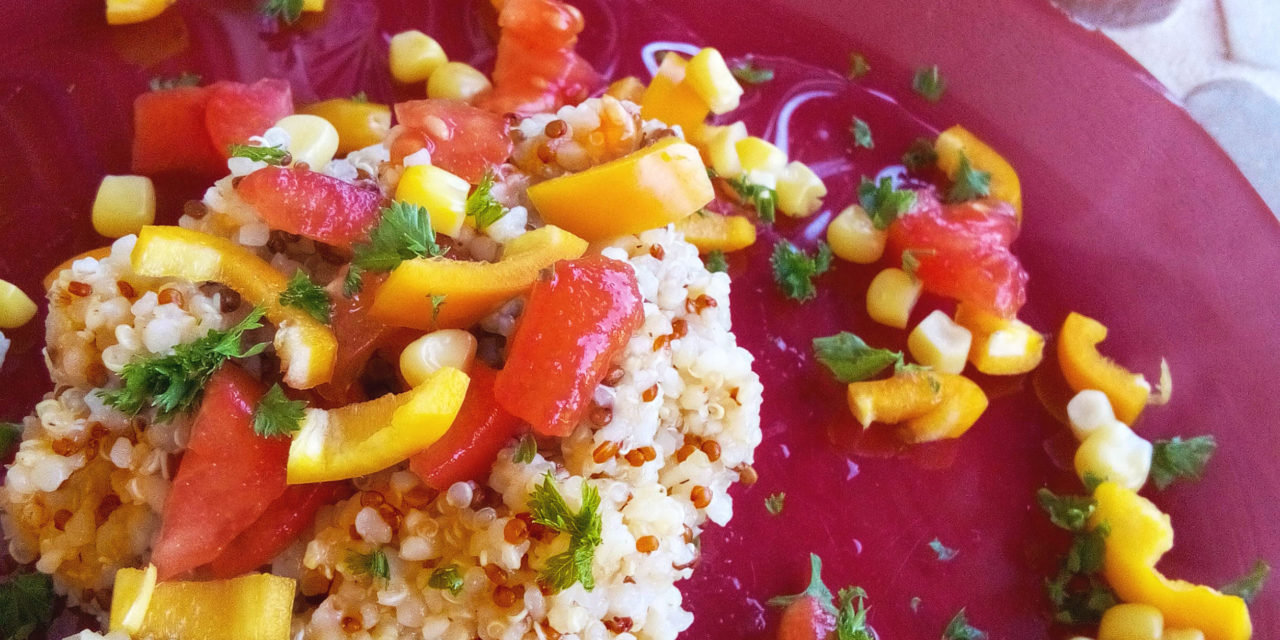 Quinoa and bulgur tabbouleh with bell peppers