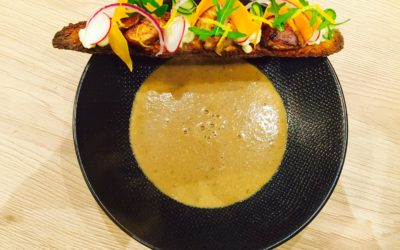 Mushroom soup and its slice of bread